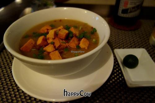 """Photo of Corner Tree Cafe  by <a href=""""/members/profile/Gudrun"""">Gudrun</a> <br/>Vegan Arroz Caldo - A big bowl of Filipino rice porridge with shiitake mushrooms topped with fried tofu, crispy garlic and spring onions <br/> March 15, 2013  - <a href='/contact/abuse/image/18567/45465'>Report</a>"""