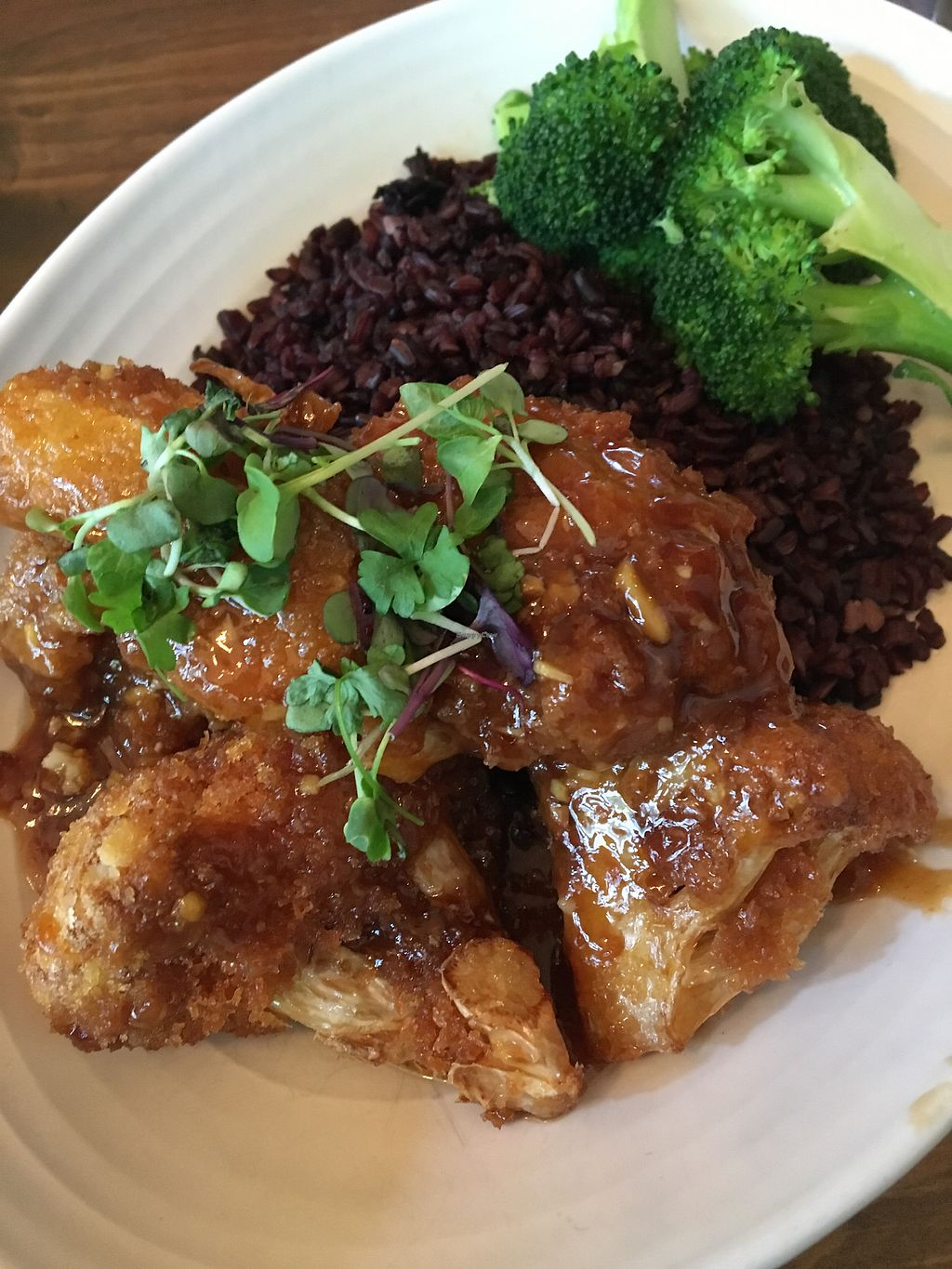 "Photo of Plum Bistro  by <a href=""/members/profile/AriTravels"">AriTravels</a> <br/>General tso cauliflower soooo crispy with forbidden rice <br/> October 20, 2017  - <a href='/contact/abuse/image/18615/316822'>Report</a>"