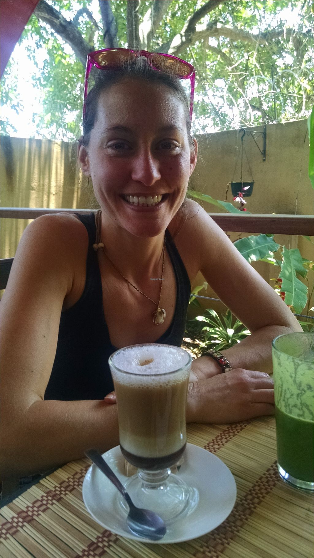 """Photo of Mantras Veggie Cafe and Tea House  by <a href=""""/members/profile/ErinBveggie"""">ErinBveggie</a> <br/>My happy self with my coffee and smoothie <br/> April 21, 2016  - <a href='/contact/abuse/image/18650/145564'>Report</a>"""