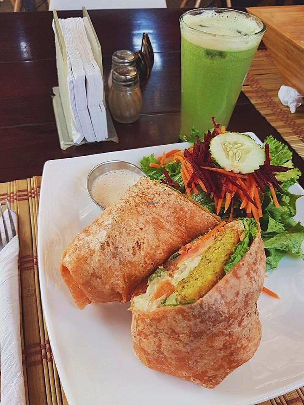 """Photo of Mantras Veggie Cafe and Tea House  by <a href=""""/members/profile/Matilda"""">Matilda</a> <br/>Vegan falafel and hummus wrap with sesame dressing <br/> February 7, 2017  - <a href='/contact/abuse/image/18650/223955'>Report</a>"""