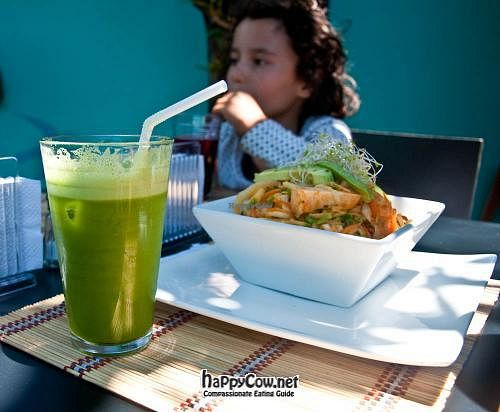 """Photo of Mantras Veggie Cafe and Tea House  by <a href=""""/members/profile/Catfo"""">Catfo</a> <br/>The yogi bowl with a green juice <br/> April 25, 2012  - <a href='/contact/abuse/image/18650/30979'>Report</a>"""