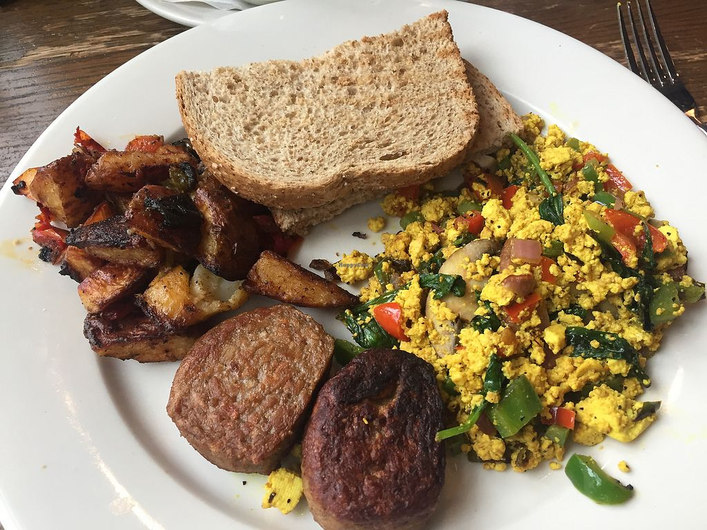 "Photo of Busboys and Poets - Langston Lofts  by <a href=""/members/profile/Raynickben"">Raynickben</a> <br/>Tofu scramble with vegan sausage, potatoes, and toast  <br/> July 28, 2017  - <a href='/contact/abuse/image/18671/285939'>Report</a>"