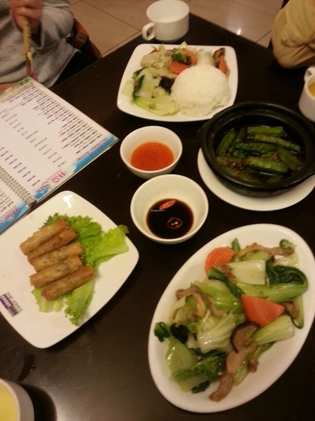 """Photo of Hoa Sen - Nha Hang Chay  by <a href=""""/members/profile/WillChadwick"""">WillChadwick</a> <br/>braised veg with rice, fried okra, spring rolls, pak choi with mushrooms <br/> May 29, 2017  - <a href='/contact/abuse/image/18728/263643'>Report</a>"""