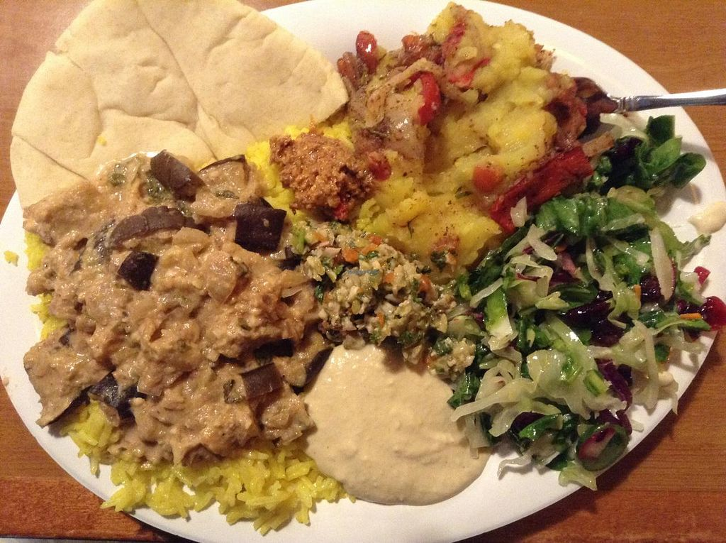 """Photo of Sanaa's 8th St. Gourmet  by <a href=""""/members/profile/plantbasedbill"""">plantbasedbill</a> <br/>Saturday buffet, eggplant something, vegan potatoes, salad and rice <br/> May 23, 2015  - <a href='/contact/abuse/image/18871/103180'>Report</a>"""