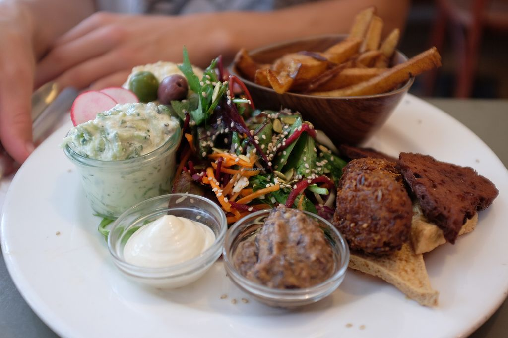 "Photo of Cafe N  by <a href=""/members/profile/hanamizu"">hanamizu</a> <br/>plate with dips, salad, falafel and fries <br/> August 31, 2017  - <a href='/contact/abuse/image/19002/299436'>Report</a>"