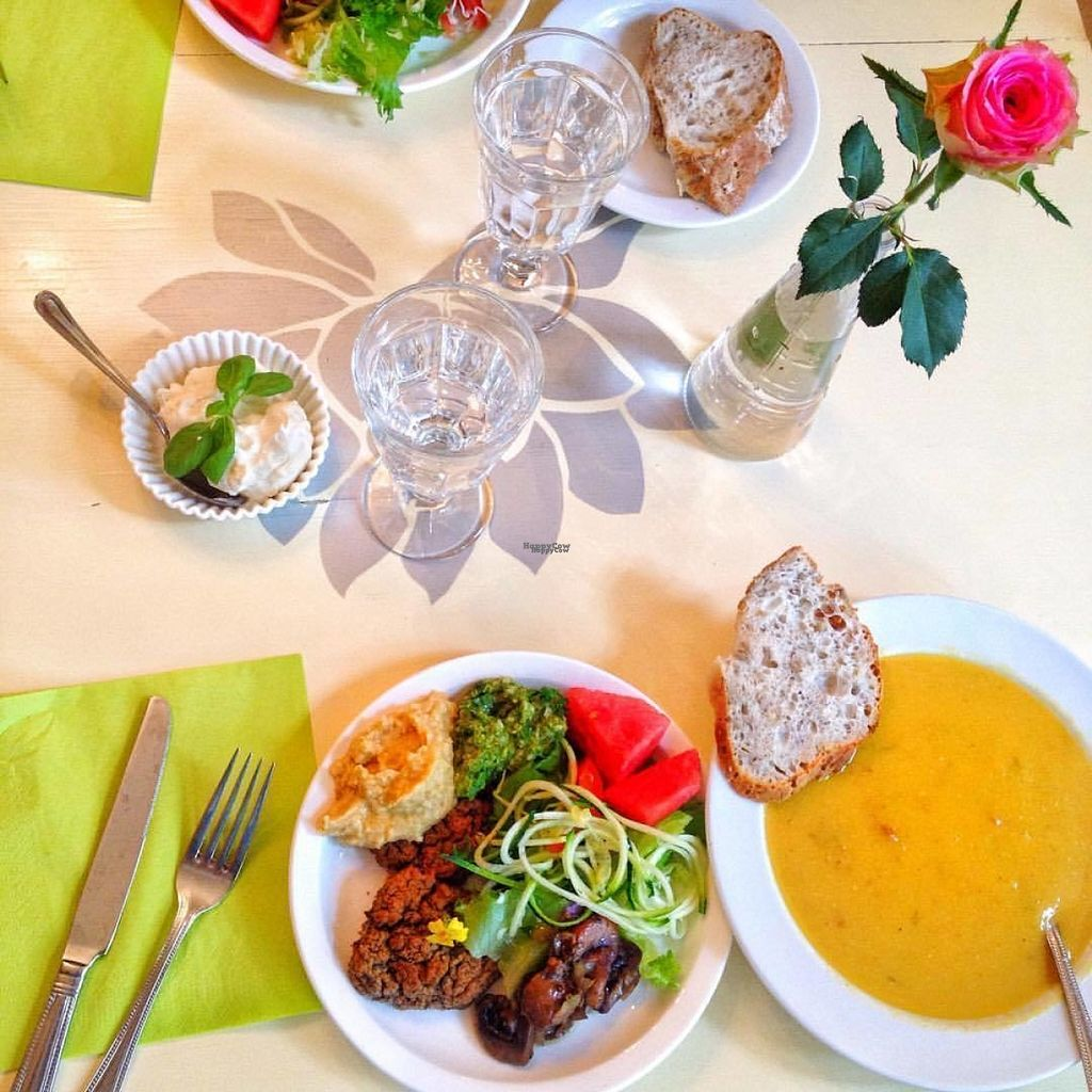 """Photo of Ani's Cafe in Fredrika's Fountain  by <a href=""""/members/profile/luuuris"""">luuuris</a> <br/>Vegetable soup and a salad plate with bean burgers, hummus, pesto, watermelon, zucchini pasta, mushrooms, baked bread and cream cheese. All vegan <br/> August 3, 2016  - <a href='/contact/abuse/image/19034/165059'>Report</a>"""