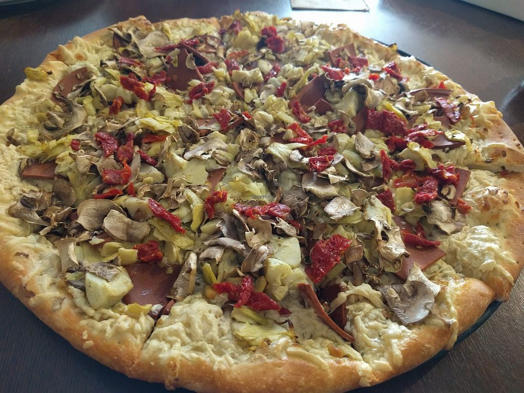 """Photo of Pizza Guru  by <a href=""""/members/profile/Sonja%20and%20Dirk"""">Sonja and Dirk</a> <br/>artichokes, sun dried tomatoes, mushrooms, pine nuts and Canadian ham with vegan garlic white sauce <br/> January 18, 2016  - <a href='/contact/abuse/image/19047/132910'>Report</a>"""