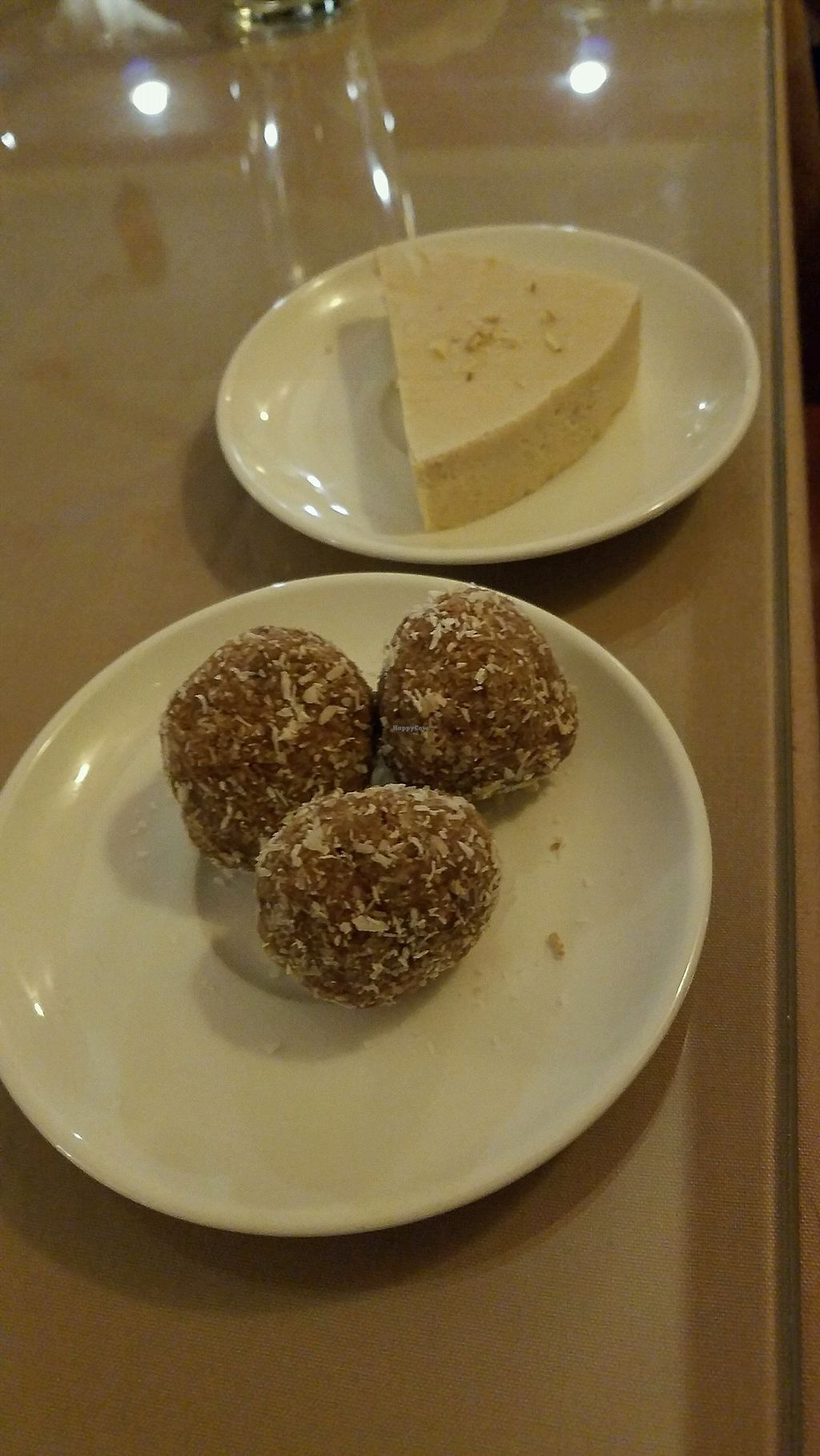 """Photo of Arya Bhavan  by <a href=""""/members/profile/gostofish"""">gostofish</a> <br/>choco coconut truffles and vegan cheesecake <br/> January 3, 2018  - <a href='/contact/abuse/image/1942/342628'>Report</a>"""