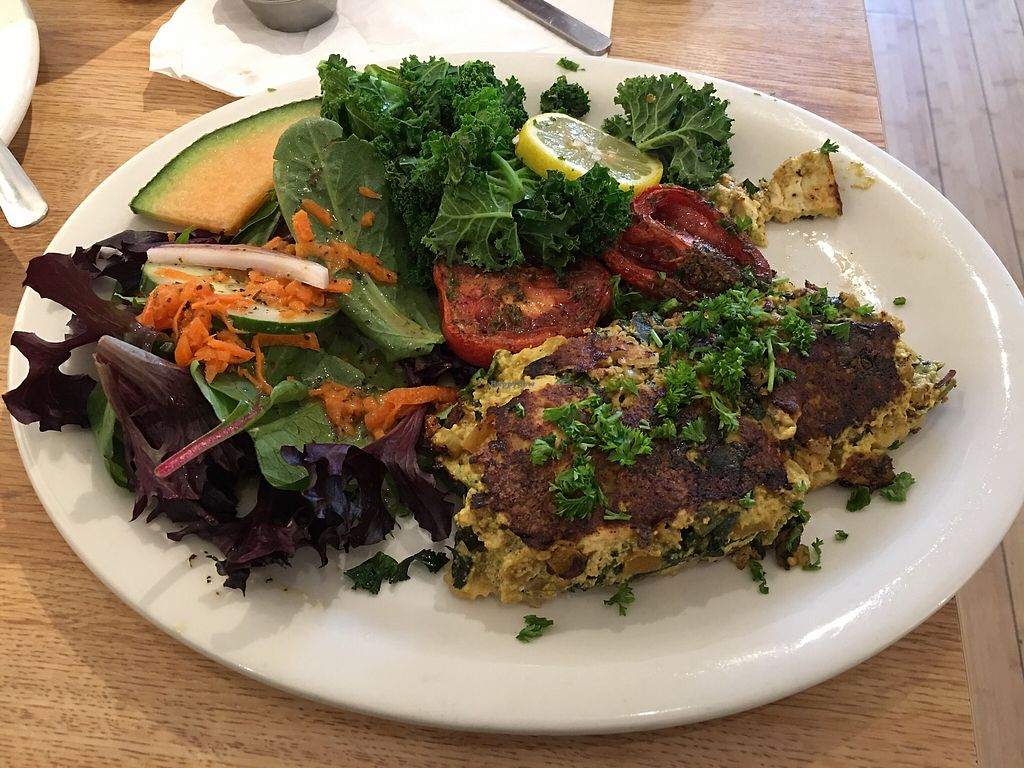 """Photo of Sluggo's North Vegetarian Cafe  by <a href=""""/members/profile/saynotopunx"""">saynotopunx</a> <br/>Mushroom, Yellow Pepper and Spinach Frittata served with Italian Herb Balsamic Roasted Roma Tomatoes, Citrus steamed fresh Kale and a Garden Salad. Not pictured - Coconut Pancakes with fresh strawberries and fruit.  <br/> March 25, 2018  - <a href='/contact/abuse/image/19466/376024'>Report</a>"""