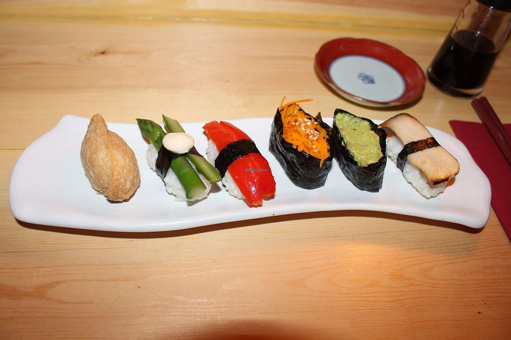 "Photo of Itadakizen  by <a href=""/members/profile/ericacrombie"">ericacrombie</a> <br/>Sushi at Itadaki Zen in London. These tasted even better than they look. Each were infused with a different flavour - I can't remember what they all were but I remember one was garlic. Amazing. We were seated at the seats at the bar underground with a pretty cool vibe to the whole thing. They also had brilliantly terrible cover songs of classics such as Bohemian Rhapsody playing and the three of us were entertained all evening trying to guess what on earth the songs were supposed to be. The music was perhaps the highlight of the whole experience hahaha.  <br/> September 23, 2017  - <a href='/contact/abuse/image/19523/307325'>Report</a>"
