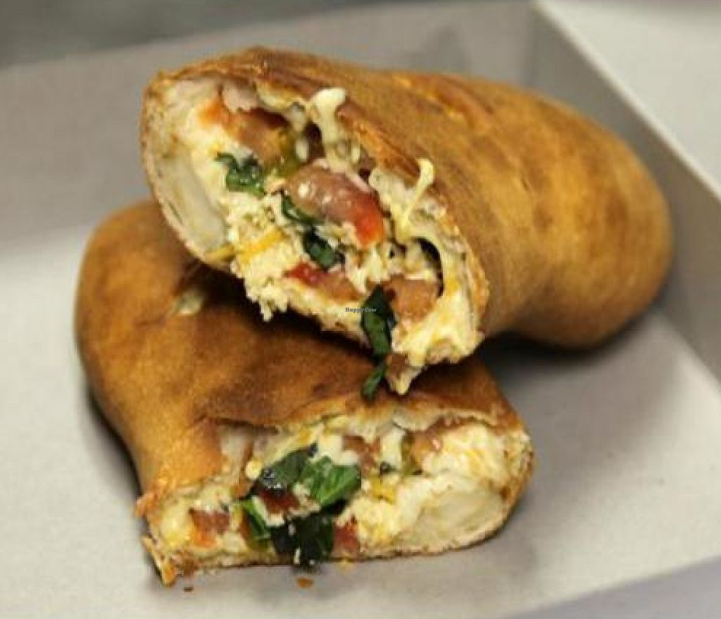 """Photo of Cruzer Pizza  by <a href=""""/members/profile/quarrygirl"""">quarrygirl</a> <br/>Vegan calzone with daiya cheese, tomatoes, and basil <br/> December 16, 2011  - <a href='/contact/abuse/image/19779/189380'>Report</a>"""
