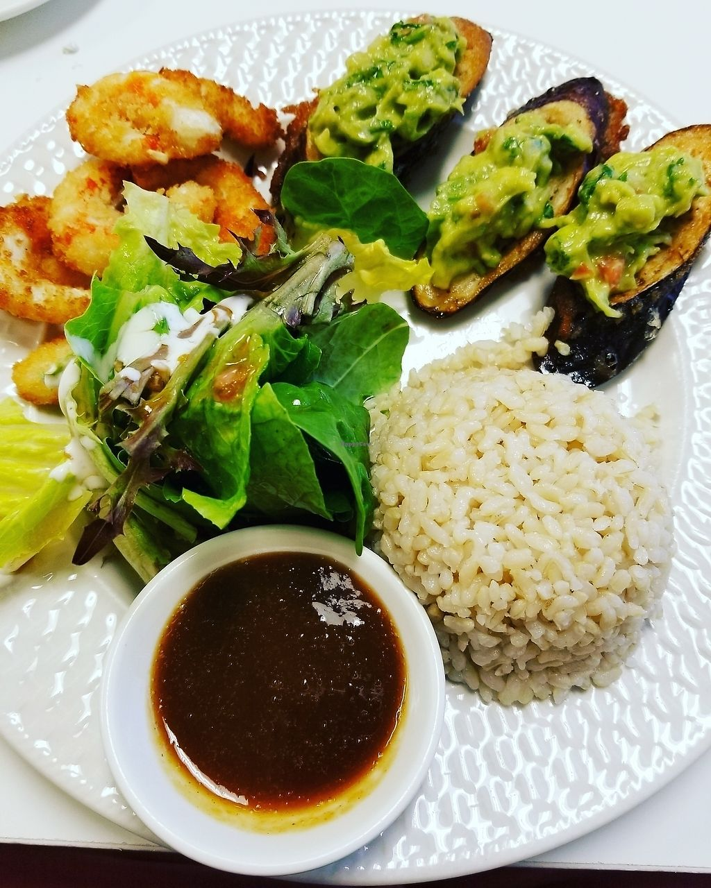 """Photo of Loving Hut - Cape Coral  by <a href=""""/members/profile/alij1126"""">alij1126</a> <br/>sea crescents, brown rice, eggplant with guac and a salad.  <br/> July 13, 2017  - <a href='/contact/abuse/image/19904/279690'>Report</a>"""