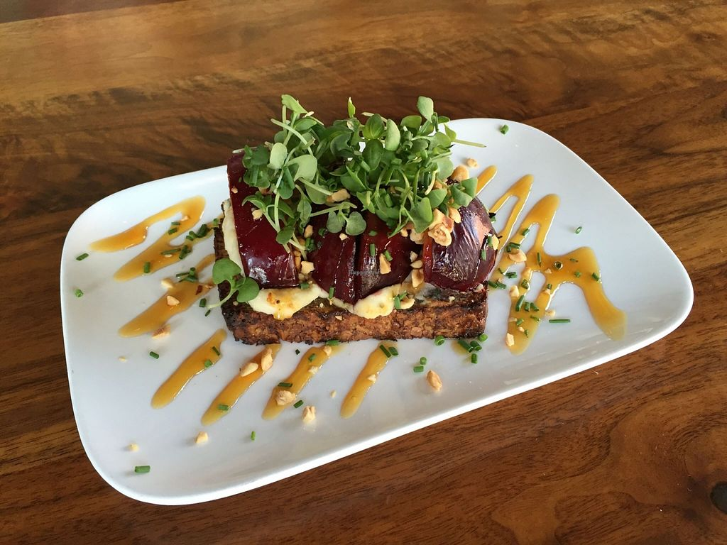 "Photo of CLOSED: Encuentro  by <a href=""/members/profile/clovely.vegan"">clovely.vegan</a> <br/>Seared stone fruit bruschetta with herbed macadamia cheese, golden balsamic reduction, hazelnuts, micro basil <br/> October 22, 2015  - <a href='/contact/abuse/image/19932/122125'>Report</a>"