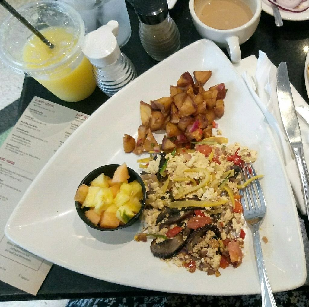 """Photo of The Cafe at Books and Books  by <a href=""""/members/profile/YuvalLalyAzrad"""">YuvalLalyAzrad</a> <br/>breakfast - tofu scramble with mushrooms, peppers and tomatoes, baked potatoes, toasts and fruits  <br/> November 21, 2017  - <a href='/contact/abuse/image/20246/327779'>Report</a>"""