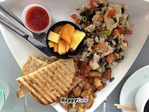 """Photo of The Cafe at Books and Books  by <a href=""""/members/profile/zanotab"""">zanotab</a> <br/>Tofu scramble with tomatoes, mushrooms and scallions. Served with toast, fruit cup (pineapple and cantaloupe) and breakfast potatoes <br/> July 30, 2013  - <a href='/contact/abuse/image/20246/52450'>Report</a>"""