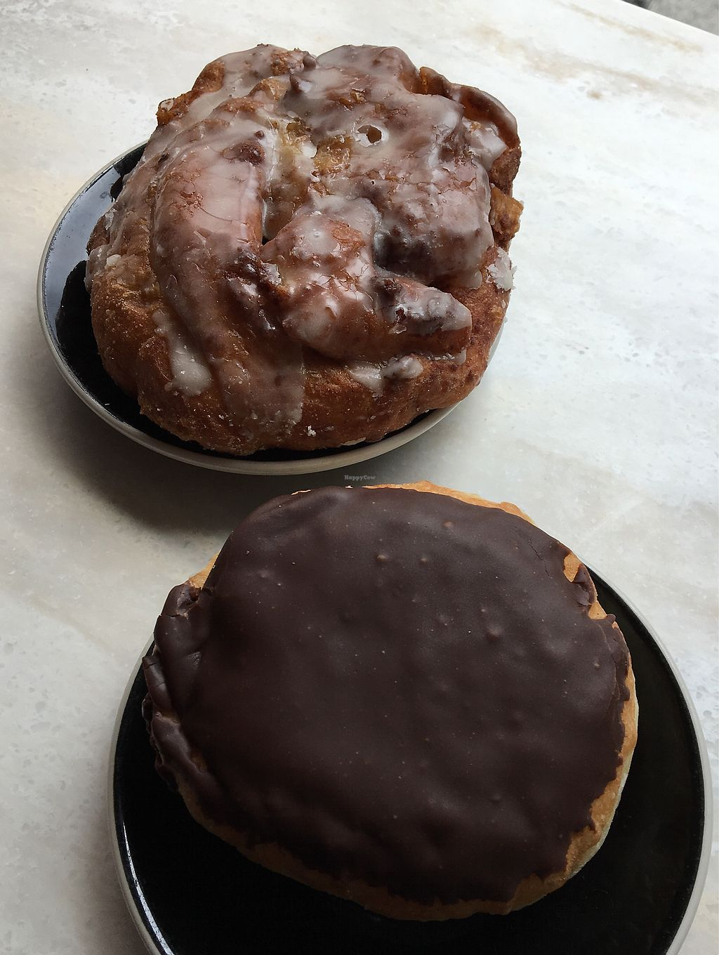 """Photo of Sweet Freedom Bakery  by <a href=""""/members/profile/Thepennsyltuckyvegan"""">Thepennsyltuckyvegan</a> <br/>apple fritter and Boston Creme <br/> June 21, 2017  - <a href='/contact/abuse/image/20302/271922'>Report</a>"""