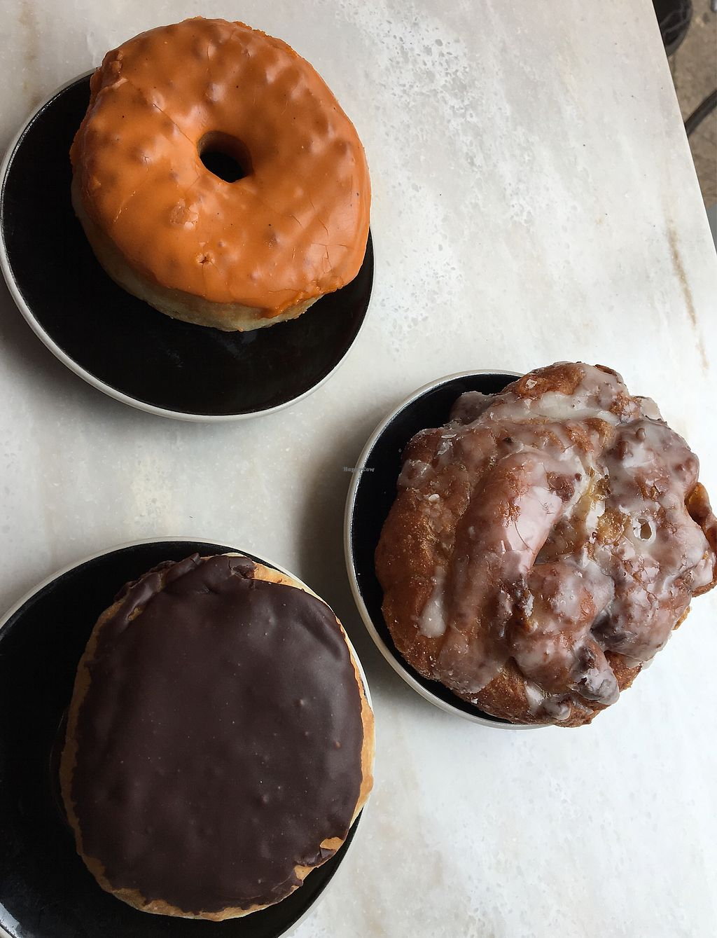 """Photo of Sweet Freedom Bakery  by <a href=""""/members/profile/Thepennsyltuckyvegan"""">Thepennsyltuckyvegan</a> <br/>apple fritter, Boston Creme, chai tea donut  <br/> June 21, 2017  - <a href='/contact/abuse/image/20302/271923'>Report</a>"""