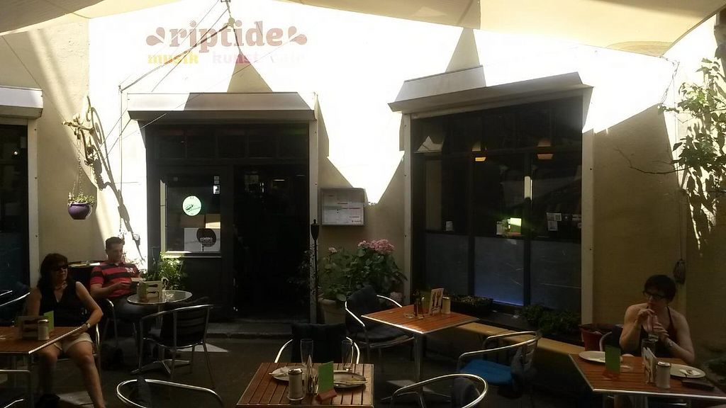 """Photo of Cafe Riptide  by <a href=""""/members/profile/fripi"""">fripi</a> <br/>Entrance with some tables <br/> July 19, 2014  - <a href='/contact/abuse/image/20667/74383'>Report</a>"""