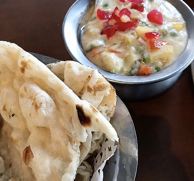 """Photo of Raj Restaurant  by <a href=""""/members/profile/Sweetveganneko"""">Sweetveganneko</a> <br/>Naan and curry <br/> March 7, 2018  - <a href='/contact/abuse/image/21186/367589'>Report</a>"""