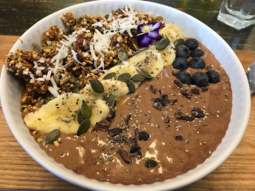 """Photo of Wise Cicada Wholefood Cafe  by <a href=""""/members/profile/Kiwivegan"""">Kiwivegan</a> <br/>Cocoa, coconut, date smoothie bowl with granola & fruit <br/> December 22, 2017  - <a href='/contact/abuse/image/21463/337984'>Report</a>"""
