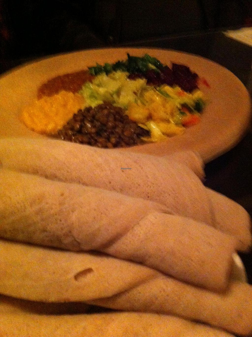"""Photo of Wass Ethiopian Restaurant  by <a href=""""/members/profile/gabynbrad"""">gabynbrad</a> <br/>Vegan Platter with injera <br/> May 4, 2014  - <a href='/contact/abuse/image/21508/69331'>Report</a>"""