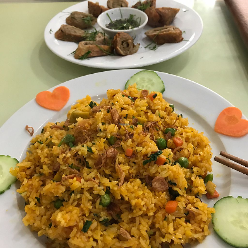 "Photo of Loving Hut - Tay Ho  by <a href=""/members/profile/Fractalphi"">Fractalphi</a> <br/>fried rice and Lemon chicken ---- Ching Hai videos playing in the background --- pure heaven  <br/> March 14, 2017  - <a href='/contact/abuse/image/21552/236571'>Report</a>"