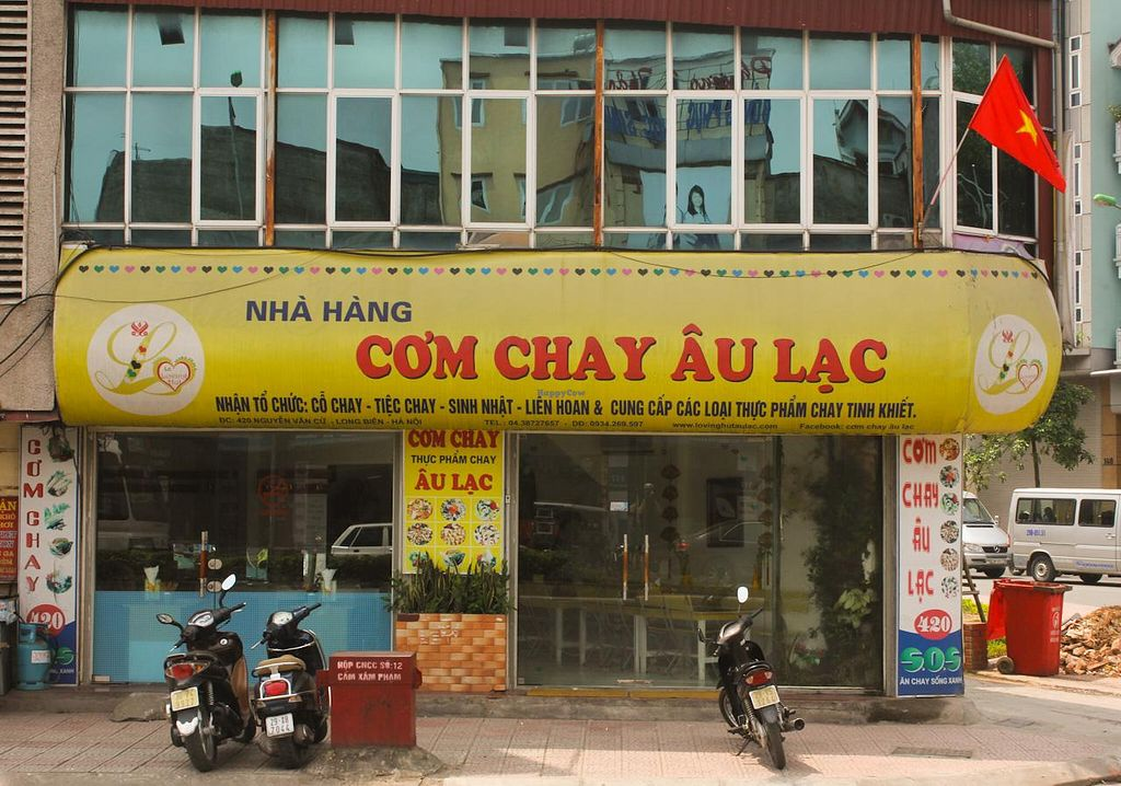 """Photo of Au Lac - Vegan House  by <a href=""""/members/profile/Ranks42"""">Ranks42</a> <br/>The restaurant's sign and entrance <br/> May 18, 2014  - <a href='/contact/abuse/image/21553/70242'>Report</a>"""