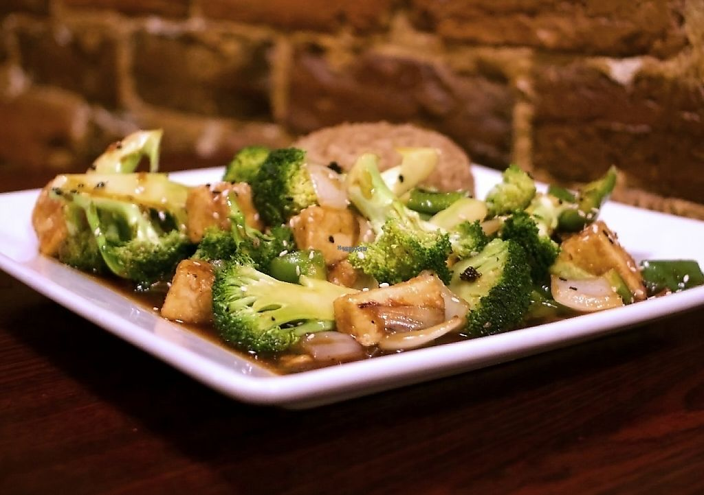 """Photo of Soy Noodle House  by <a href=""""/members/profile/cbquispe"""">cbquispe</a> <br/>Sesame tofu and broccoli served with fried rice. Photo take by cbquispe.com <br/> December 7, 2016  - <a href='/contact/abuse/image/21601/198952'>Report</a>"""