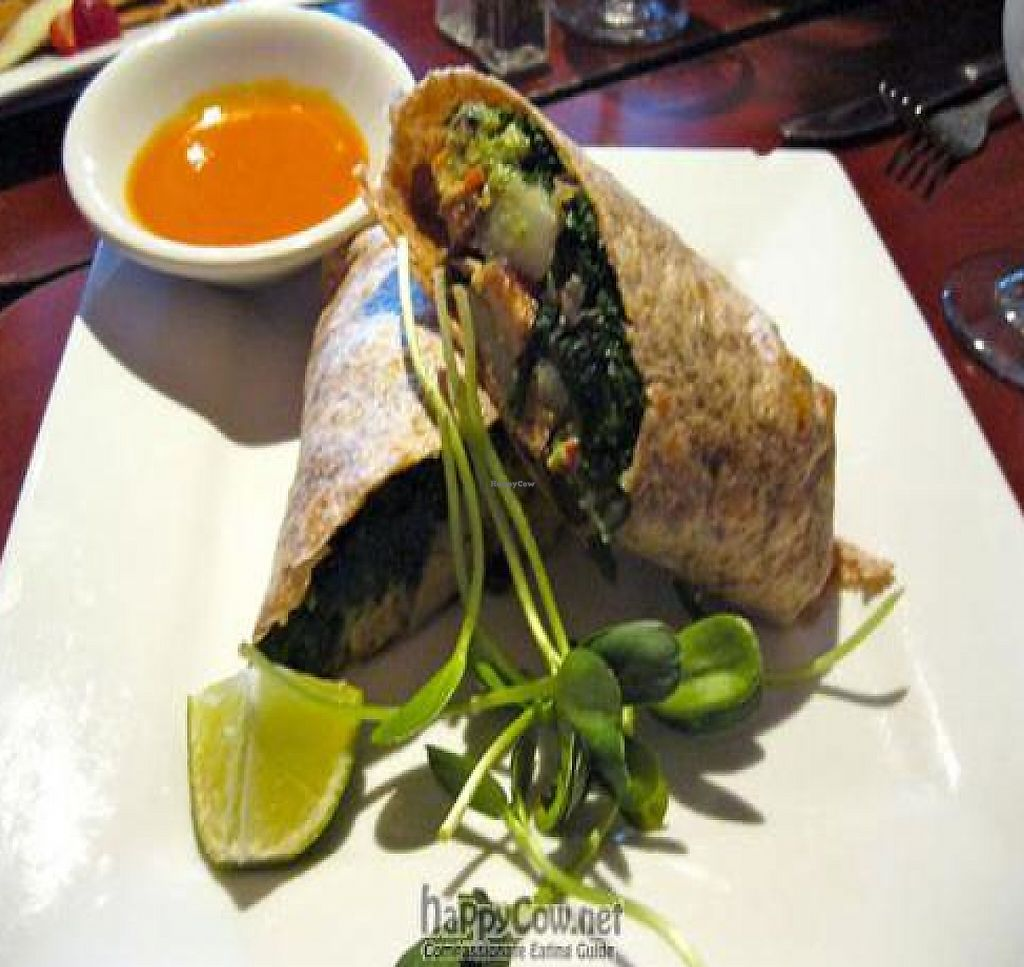 "Photo of Caravan of Dreams  by <a href=""/members/profile/From%20A%20to%20Vegan"">From A to Vegan</a> <br/>Breakfast Burrito with potatoes, sautéed kale, guacamole, smoked tofu, chile de árbol <br/> August 16, 2011  - <a href='/contact/abuse/image/2261/210682'>Report</a>"