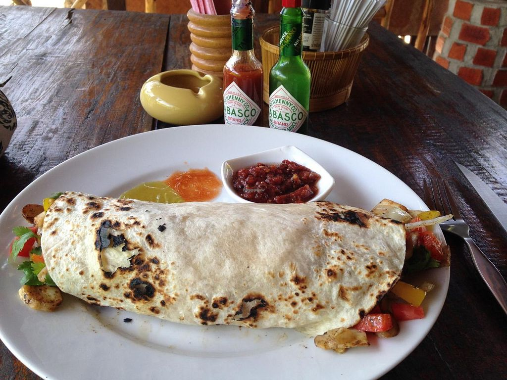 """Photo of Rusty Pelican  by <a href=""""/members/profile/Foodislove"""">Foodislove</a> <br/>Chicken/Beef Grande Burrito I asked to make it vegetarian, and leave off any cheese or sour cream <br/> April 24, 2015  - <a href='/contact/abuse/image/22858/100165'>Report</a>"""