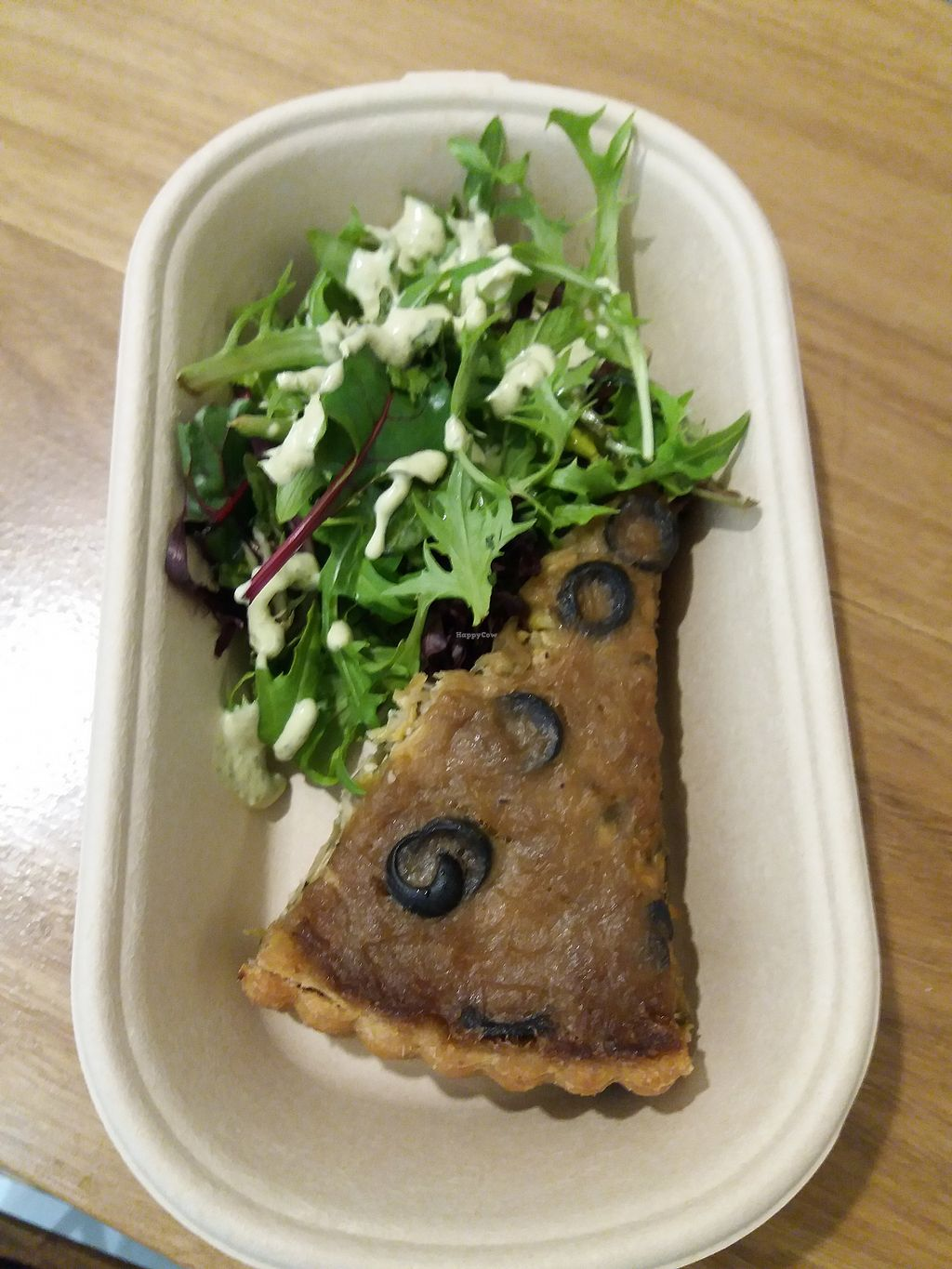 """Photo of Iku Wholefood Kitchen - Greenwood Plaza  by <a href=""""/members/profile/veganvirtues"""">veganvirtues</a> <br/>Caramilised leek, onion and chick pea tart <br/> September 19, 2017  - <a href='/contact/abuse/image/23181/305959'>Report</a>"""