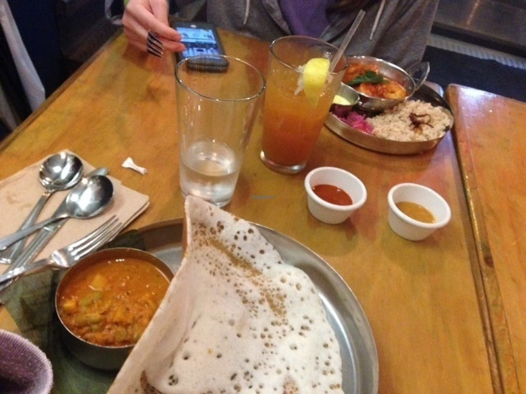 "Photo of Vimala's Curryblossom Cafe  by <a href=""/members/profile/MollyJD17"">MollyJD17</a> <br/>Shrimp malabar with brown rice, coconut and rice pancake with veggie curry, mango iced tea <br/> May 28, 2017  - <a href='/contact/abuse/image/23534/263207'>Report</a>"