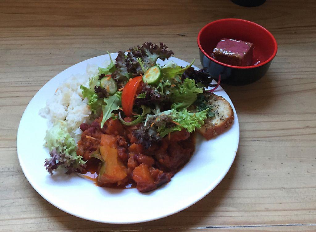 """Photo of CLOSED: Lentil As Anything - Footscray   by <a href=""""/members/profile/Wuji_Luiji"""">Wuji_Luiji</a> <br/>pumpkin and bean curry with salad and cake with strawberry topping  <br/> January 12, 2017  - <a href='/contact/abuse/image/23571/256678'>Report</a>"""