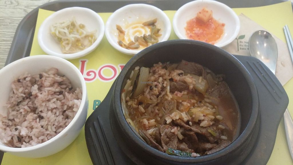 "Photo of Loving Hut Gangnam-gu - 러빙헛  by <a href=""/members/profile/TrinaRowell"">TrinaRowell</a> <br/>Bulgoggi  vegan jiggae (stew) with mixed rice and several side dishes, half eaten.  