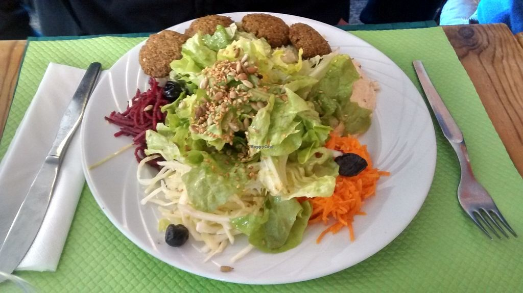 """Photo of Le Tournesol Cuisine Vegetarienne  by <a href=""""/members/profile/JonJon"""">JonJon</a> <br/>Libanese plate: hummus, falafel, taboulé and salad <br/> February 21, 2016  - <a href='/contact/abuse/image/23963/137293'>Report</a>"""