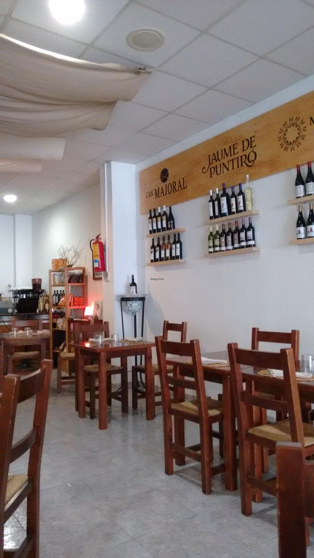 """Photo of Es Ginebro  by <a href=""""/members/profile/craigmc"""">craigmc</a> <br/>Interior with organic wines <br/> May 31, 2015  - <a href='/contact/abuse/image/24440/104280'>Report</a>"""