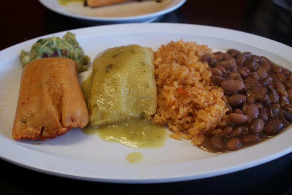 "Photo of Casa de Tamales  by <a href=""/members/profile/RachaelSera"">RachaelSera</a> <br/>Tamales and rice and beans <br/> June 1, 2015  - <a href='/contact/abuse/image/24482/104451'>Report</a>"