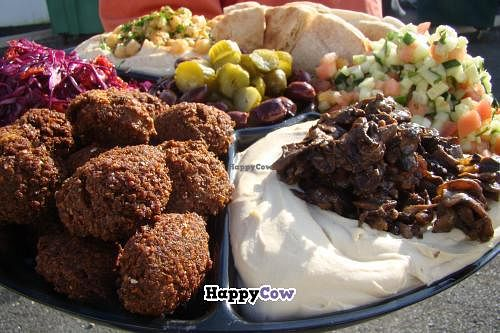 "Photo of CLOSED: Uncle Jack's Good 2 Go  by <a href=""/members/profile/Good2Go"">Good2Go</a> <br/>Large catering platter.  Left front is Falafel, directly to the right is Shroomus (hummus topped with sauteed mushrooms & onions).  Also on the platter - red cabbage salad, tomato & cucumber salad, original hummus, pickles, olives, and pita <br/> December 9, 2013  - <a href='/contact/abuse/image/24483/60106'>Report</a>"