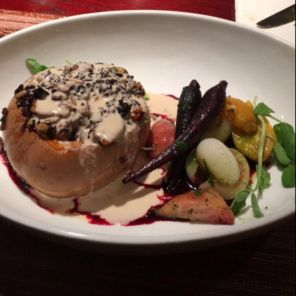 "Photo of Blue Sage Vegetarian Grille  by <a href=""/members/profile/VeggieGastronaut"">VeggieGastronaut</a> <br/>squash stuffed with a rice and berry mixture topped with cashew ""cheese"" sauce and sitting on a red wine berry reduction. Roasted carrots, onion, golden and red beets, and tomatoes.  <br/> April 5, 2017  - <a href='/contact/abuse/image/2461/245022'>Report</a>"