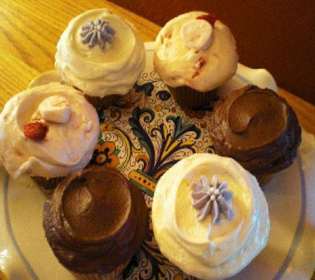 "Photo of Bloom Bake Shop  by <a href=""/members/profile/ali.seiter"">ali.seiter</a> <br/>Banana cupcake with chocolate buttercream, spiced pumpkin rum cupcake with maple cream cheese frosting, and strawberry-banana cupcake--all vegan! <br/> October 28, 2011  - <a href='/contact/abuse/image/24667/188519'>Report</a>"