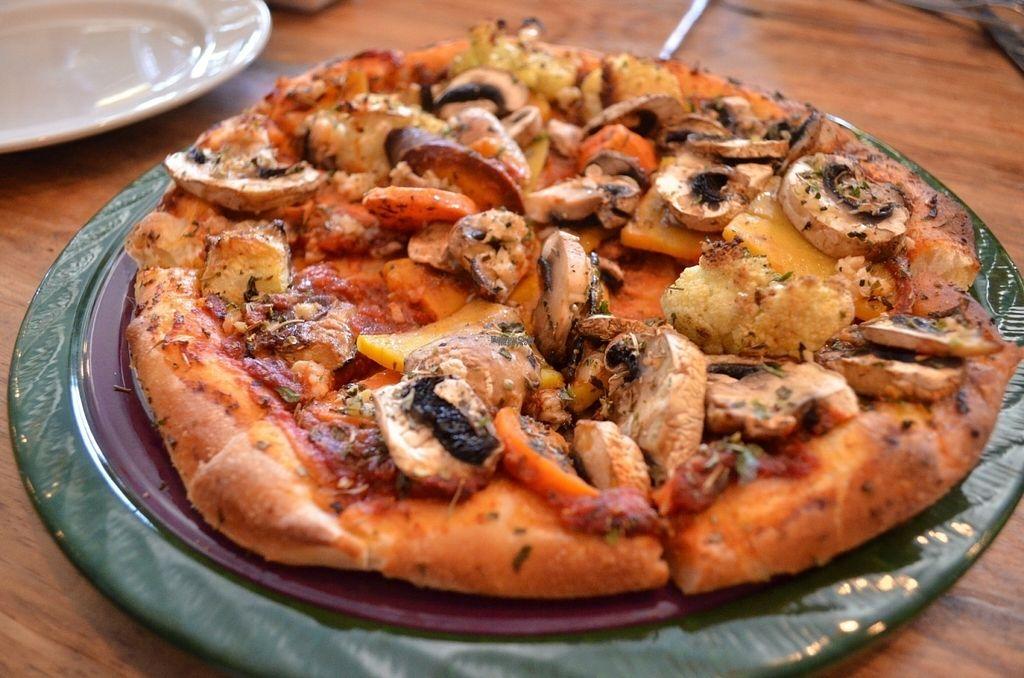 "Photo of Julia's Vegetarian Cuisine  by <a href=""/members/profile/alexandra_vegan"">alexandra_vegan</a> <br/>Julia's Pizza - vegan on request - Roasted vegetables, mozzarella, mushrooms <br/> October 2, 2016  - <a href='/contact/abuse/image/25070/179321'>Report</a>"
