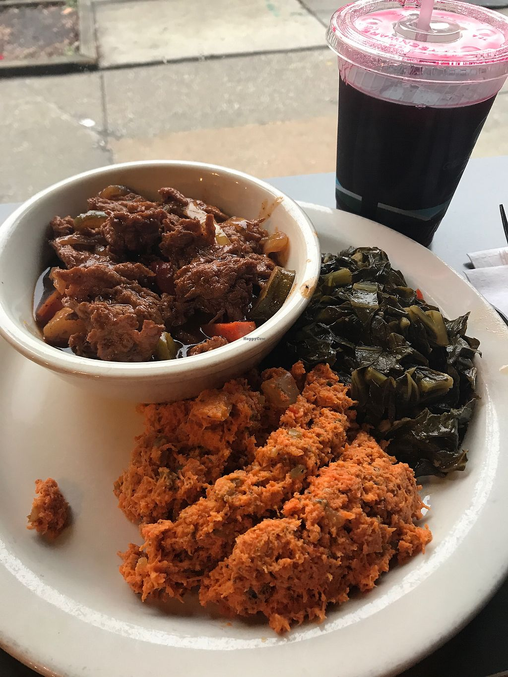 """Photo of The Land of Kush  by <a href=""""/members/profile/Birgit"""">Birgit</a> <br/>BBQ ribs, collard greens, carrot tuna salad and sorrel drink <br/> February 25, 2018  - <a href='/contact/abuse/image/25073/363820'>Report</a>"""
