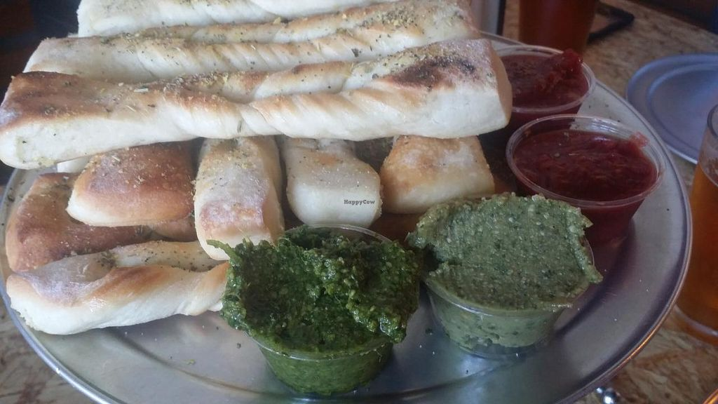 "Photo of Sizzle Pie - East Burnside  by <a href=""/members/profile/The%20Hungry%20Vegan"">The Hungry Vegan</a> <br/>Breadsticks with cilantro pesto and basil cashew sauces <br/> July 25, 2015  - <a href='/contact/abuse/image/25112/110905'>Report</a>"