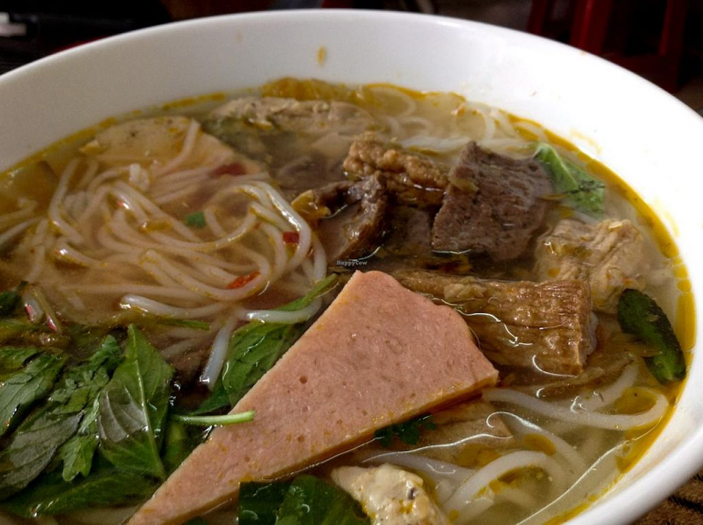 "Photo of Thuy  by <a href=""/members/profile/Ranks42"">Ranks42</a> <br/>Bún Bò Huế Chay 20,000 VND (A noodle soup with faux beef and pork with tofu and a tasty broth.) <br/> July 5, 2014  - <a href='/contact/abuse/image/25830/73290'>Report</a>"