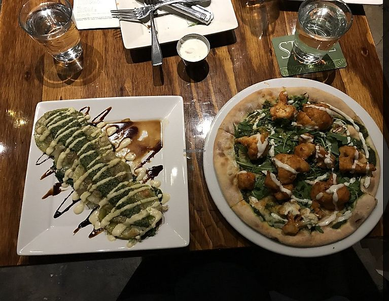 """Photo of Sage Vegan Bistro and KindKreme  by <a href=""""/members/profile/ForGoodnessSeyks"""">ForGoodnessSeyks</a> <br/>Raviolis and Pizza <br/> May 10, 2018  - <a href='/contact/abuse/image/26073/398009'>Report</a>"""