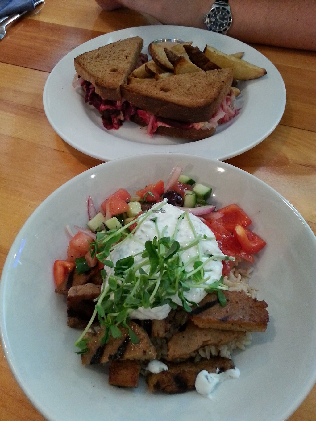 """Photo of Rise Above Restaurant and Bakery  by <a href=""""/members/profile/Vegan%20GiGi"""">Vegan GiGi</a> <br/>Seitan souvlaki bowl, and smoked beet reuben with potato wedges. YUM <br/> September 25, 2016  - <a href='/contact/abuse/image/26245/177841'>Report</a>"""