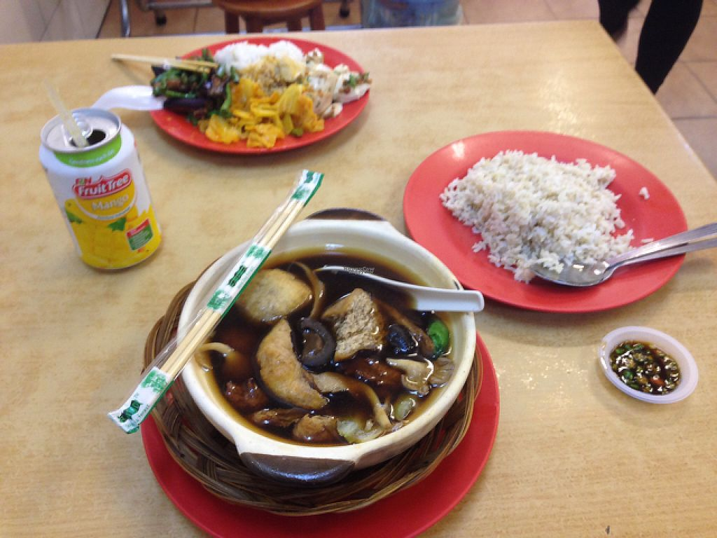 """Photo of Sweet Veggie  by <a href=""""/members/profile/Tofulicious"""">Tofulicious</a> <br/>Rice and buffet dishes in background, buk kut teh with brown rice in foreground  <br/> February 18, 2017  - <a href='/contact/abuse/image/26418/227873'>Report</a>"""