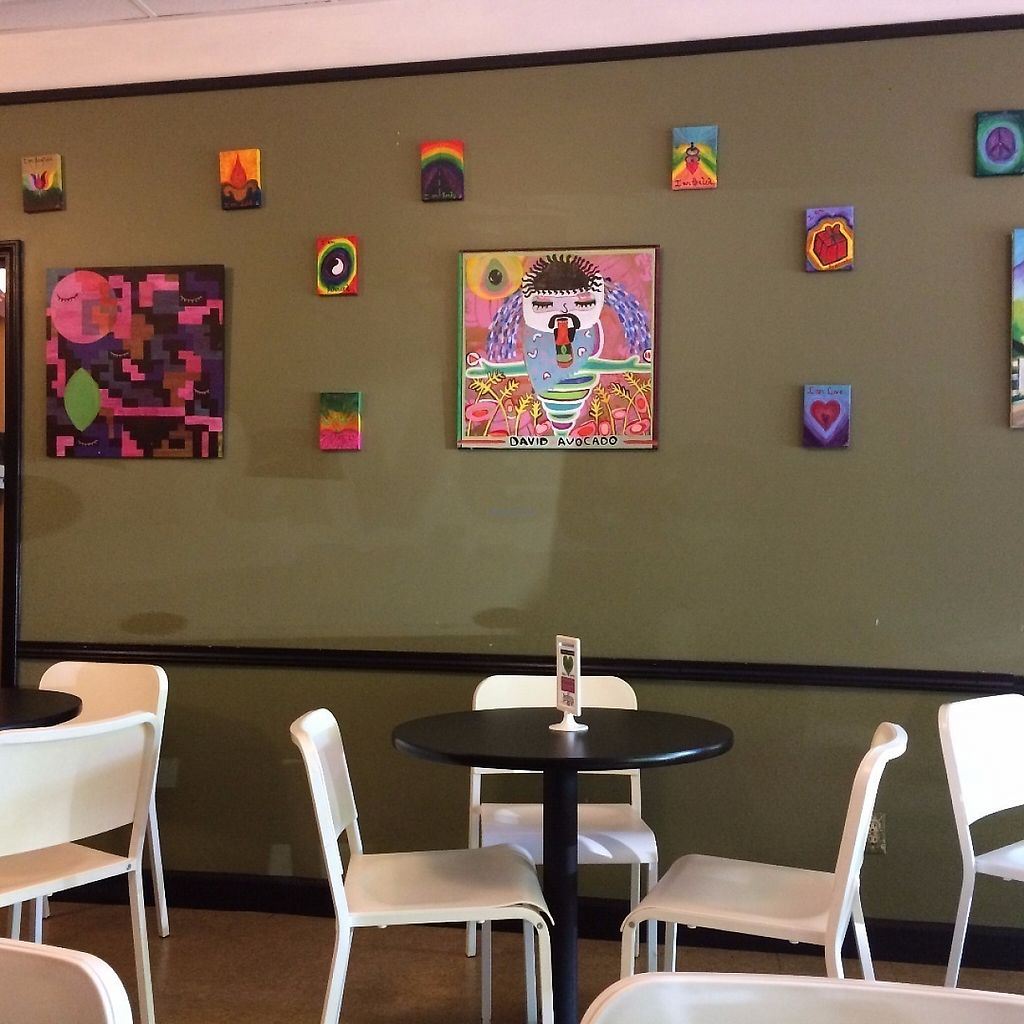 """Photo of PuraVegan  by <a href=""""/members/profile/KatieBush"""">KatieBush</a> <br/>paintings on the wall in the cafe. love the one of david wolfe! <br/> June 6, 2017  - <a href='/contact/abuse/image/26482/266322'>Report</a>"""