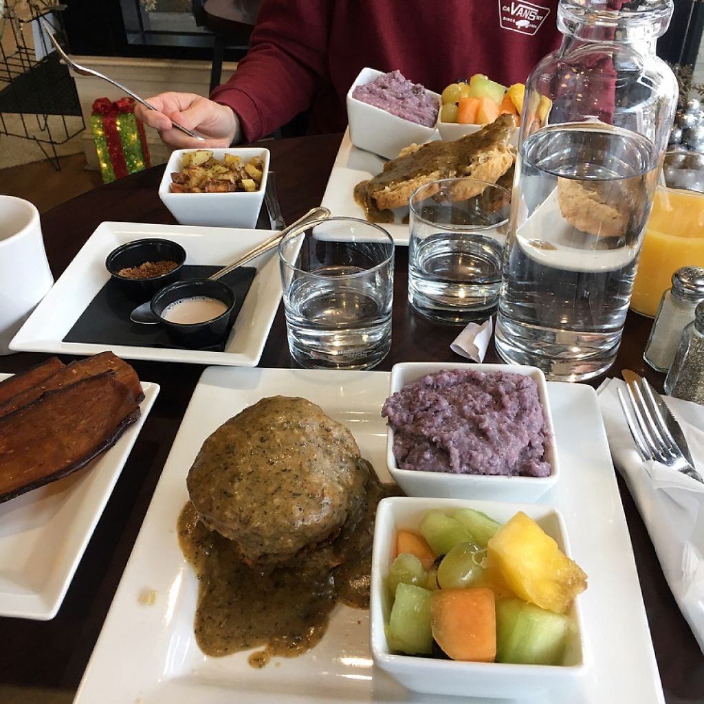 """Photo of Good Life Cafe  by <a href=""""/members/profile/JasmineH"""">JasmineH</a> <br/>Brunch: eggplant bacon, tempeh sausage, biscuits and gravy, blue grits, roasted potatoes, fruit <br/> January 1, 2017  - <a href='/contact/abuse/image/26543/206874'>Report</a>"""