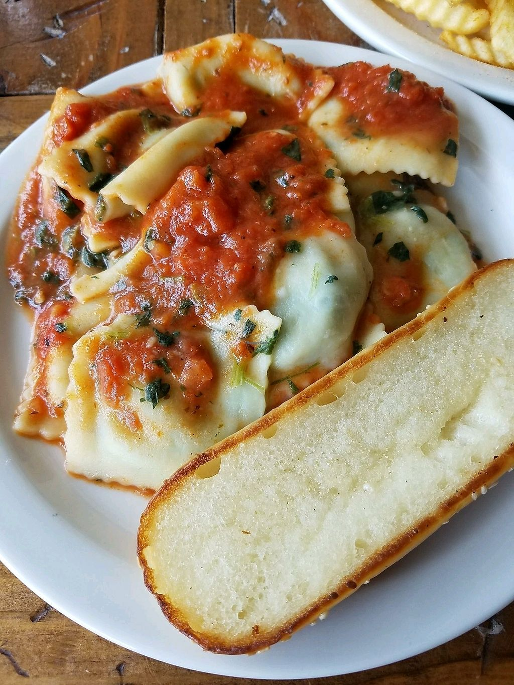 """Photo of Imagine Vegan Cafe  by <a href=""""/members/profile/NickJ"""">NickJ</a> <br/>Spinach Ravioli <br/> October 2, 2017  - <a href='/contact/abuse/image/26621/311157'>Report</a>"""